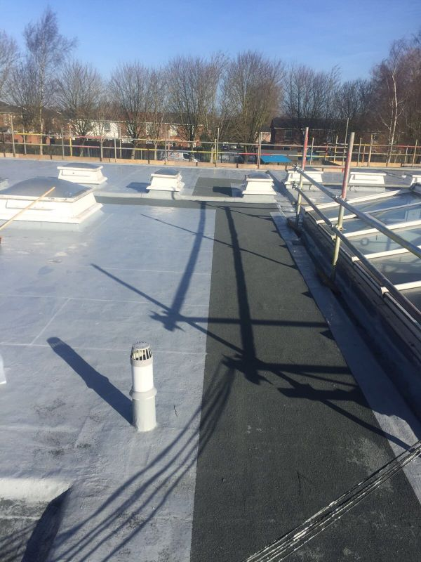 Absolute roofing gallery for Flat roof waterproofing paint