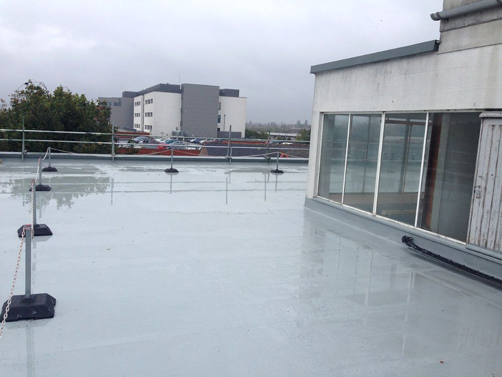 Absolute roofing liquid applied waterproof systems for Flat roof waterproofing paint